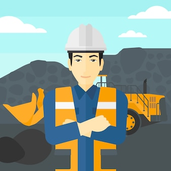 Górnik ze sprzętem górniczym