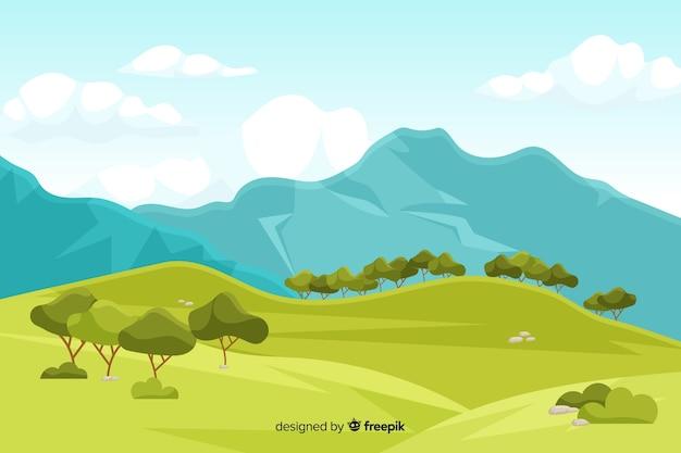 Góry kształtują teren tło z drzewami