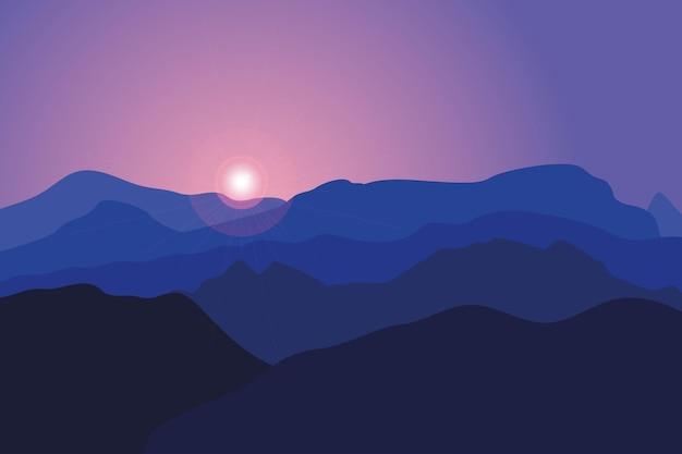 Góry o wschodzie słońca. tło z krajobrazem niebieskich wzgórz i skał.