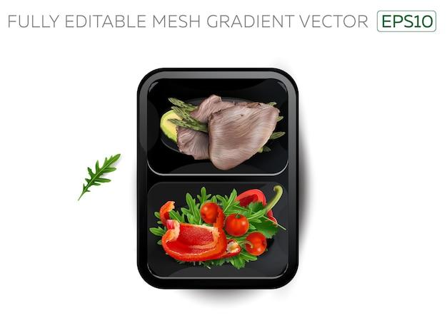 Gotowane mięso z warzywami i awokado w lunchboxie.