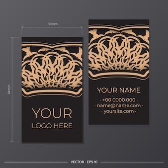 Gotowy do druku projekt wizytówki z luksusowymi wzorami. projekt wizytówki w kolorze czarnym z greckimi ornamentami.