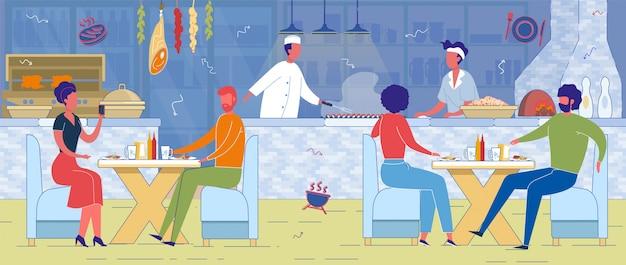 Gotuj smażoną kiełbasę na grillu w otwartej kuchni w kawiarni