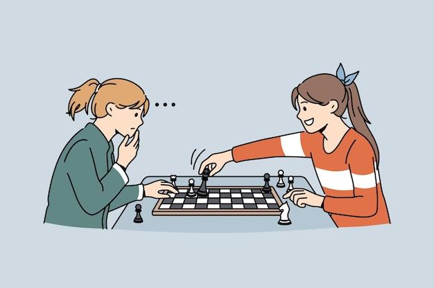 Gra intelektualna i koncepcja gry w szachy. dwie małe dziewczynki siedzące myśląc o strategii grającej w szachy czując sprytną ilustrację wektorową
