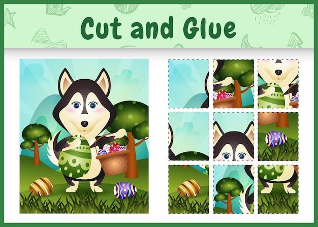 Gra planszowa dla dzieci wycinanie i klejenie wielkanocnych motywów z uroczym husky trzymającym jajko w kształcie wiadra i jajko wielkanocne