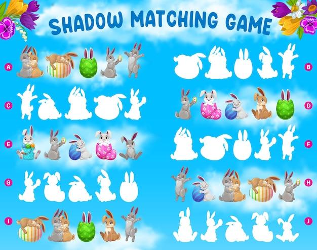 Gra w dopasowywanie cieni dla dzieci z wielkanocnymi królikami i dekorowanymi jajkami