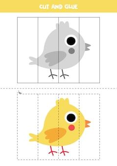 Gra w wycinanie i klejenie dla dzieci. ilustracja ładny mały żółty kurczak. ćwiczenie cięcia dla przedszkolaków. arkusz edukacyjny dla dzieci.