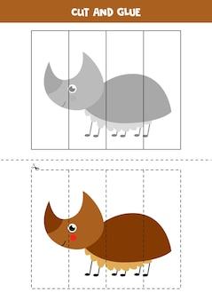Gra w wycinanie i klejenie dla dzieci z uroczym chrząszczem nosorożca. ćwiczenie cięcia dla przedszkolaków.