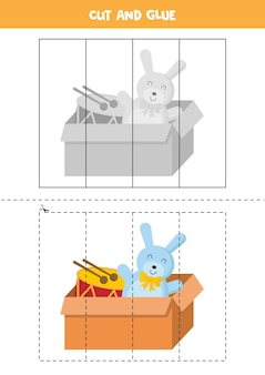 Gra w wycinanie i klejenie z kreskówkowym pudełkiem pełnym zabawek. gra edukacyjna dla dzieci. puzzle dla dzieci.