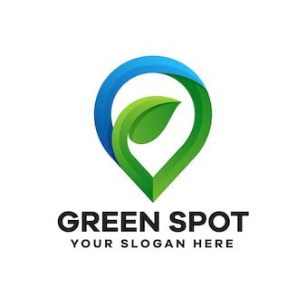 Gradientowe logo z zieloną plamką