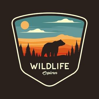 Graficzna ilustracja odznaki wildlife explorer