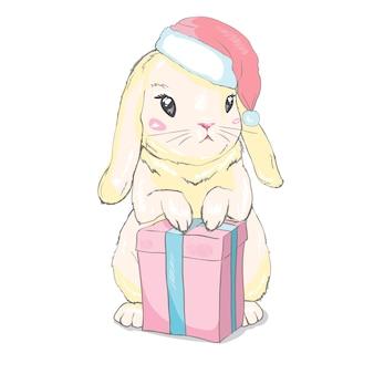 Graficzny króliczek w czapce mikołaja z prezentem świątecznym