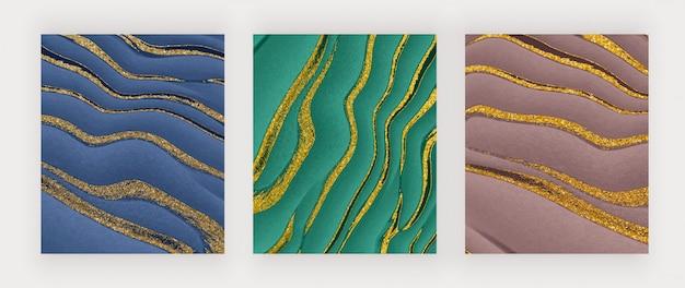 Granatowo-zielony i brązowy płyn ze złotym brokatowym tuszem abstrakcyjne tła.