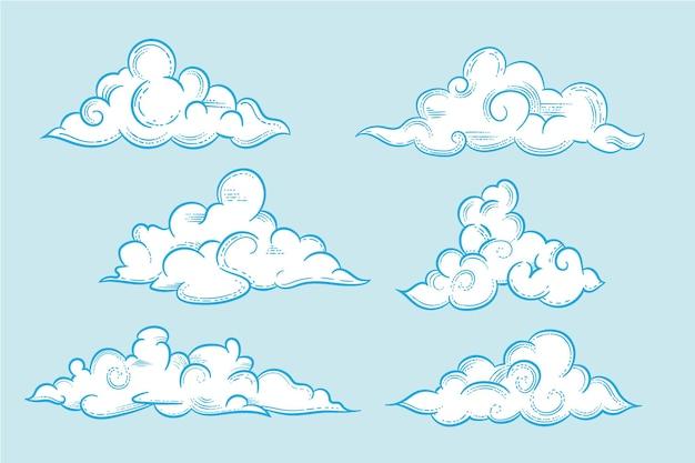 Grawerowanie ręcznie rysowane chmury w kolekcji nieba