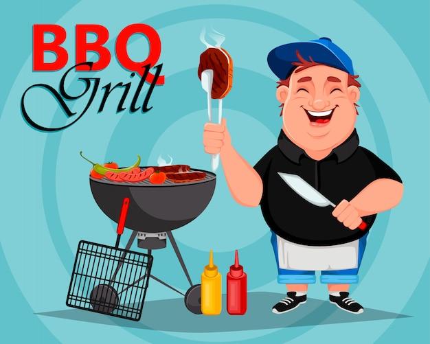 Grill. młody wesoły człowiek gotuje mięso z grilla