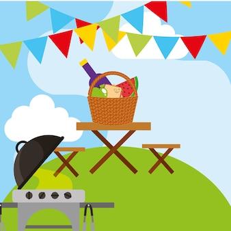 Grill piknikowy i drewniany stół