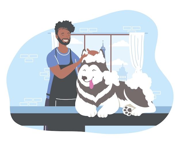 Groomer kąpiący psa