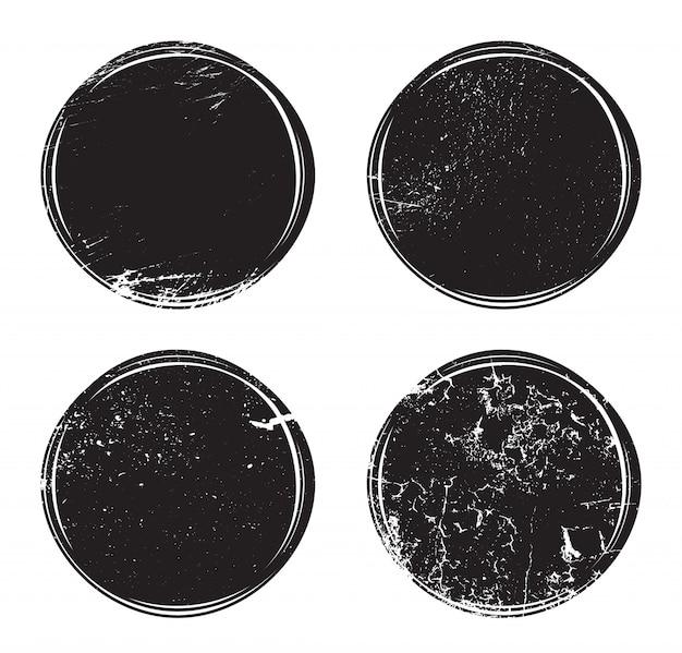 Grunge okrągłe znaczki pocztowe z brudnymi zadrapaniami.