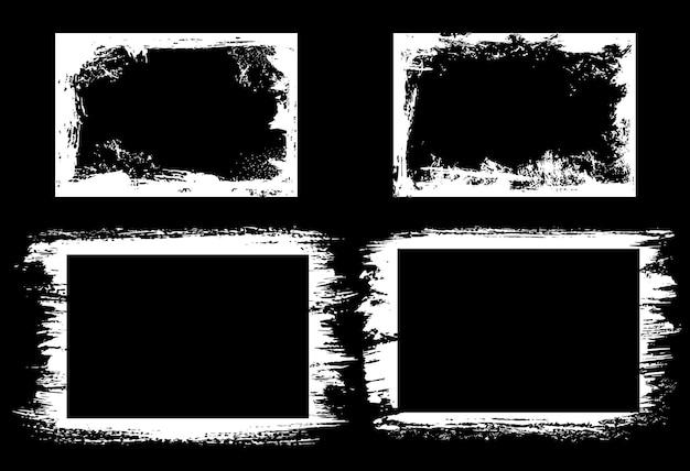 Grunge ramki i obramowania z krawędziami obrysu pędzla białej farby na czarnym tle