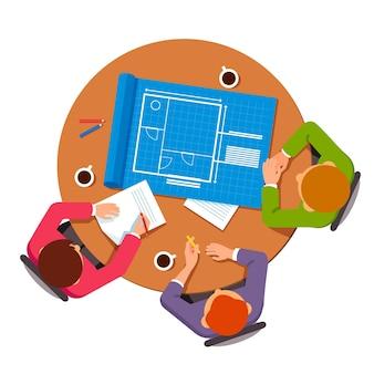 Grupa architektów omawiająca plany budowlane