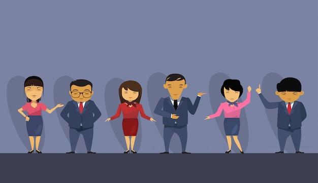 Grupa azjatykci ludzie biznesu jest ubranym kostiumy