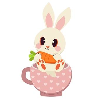 Grupa białego królika i marchewki w filiżance.