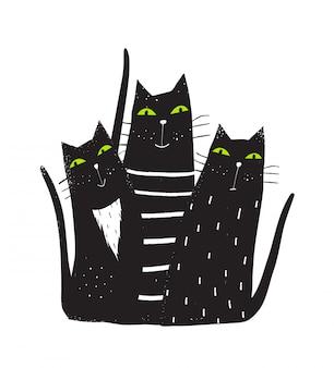 Grupa czarnych kotów siedzi