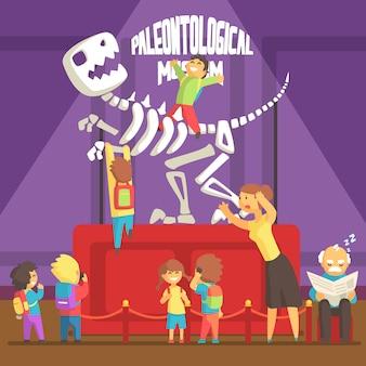 Grupa dzieci robi bałagan w muzeum paleontologii szkieletem t-rex