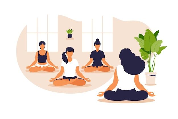Grupa jogi. równowaga pozycji i rozciąganie. ludzie siedzący razem w pozycji lotosu