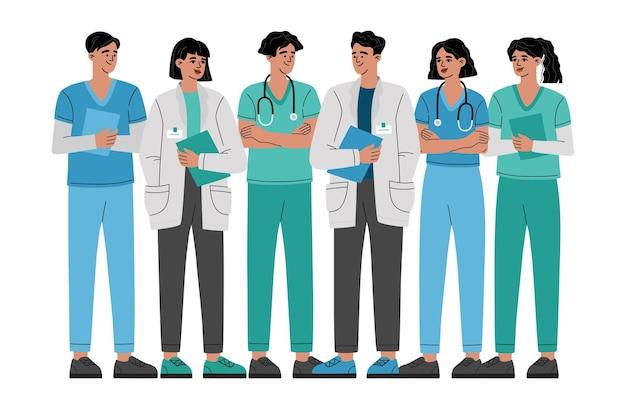 Grupa lekarzy, pielęgniarek i personelu medycznego, pracownicy pierwszej linii opieki zdrowotnej, bohaterowie.
