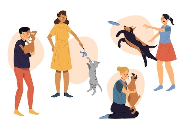 Grupa ludzi bawiących się ze swoimi zwierzętami domowymi