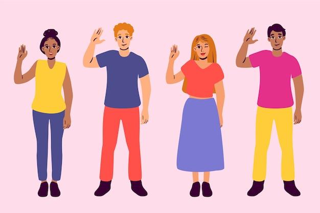 Grupa ludzi macha ręką