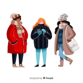 Grupa ludzi noszących ubrania zimowe
