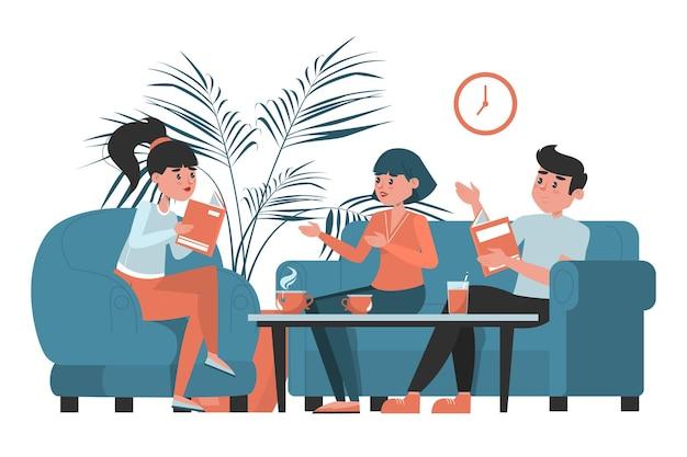 Grupa ludzi siedzi w kawiarni i omawia książkę