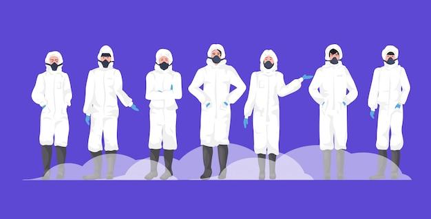 Grupa ludzi w kombinezonach i maskach ochronnych, aby zapobiec epidemii mers-cov wuhan coronavirus 2019-ncov pandemia medyczne ryzyko zdrowotne pełna długość pozioma