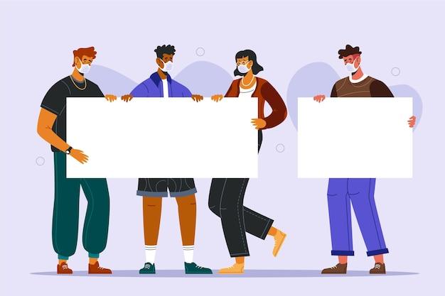 Grupa ludzi w maskach medycznych z tabliczkami