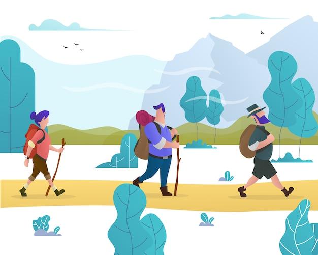 Grupa ludzi z plecakami wędruje po lesie i górach.