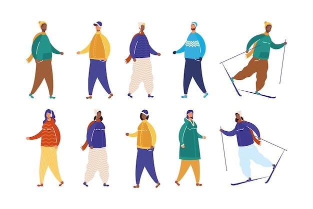 Grupa międzyrasowych osób w zimowych ubraniach uprawiających narciarstwo