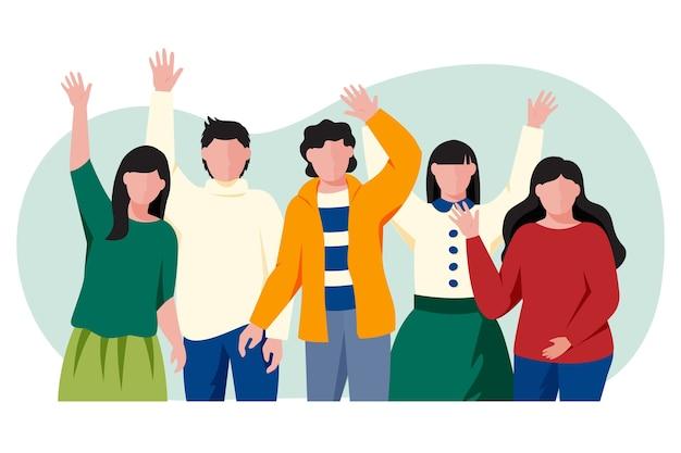 Grupa młodych ludzi macha ręką