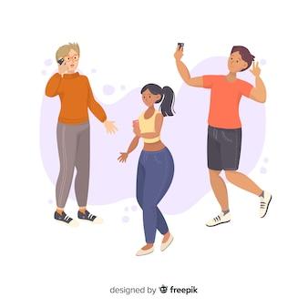 Grupa młodych ludzi posiadających smartfony