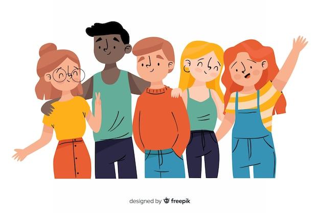 Grupa młodych ludzi pozuje do zdjęcia
