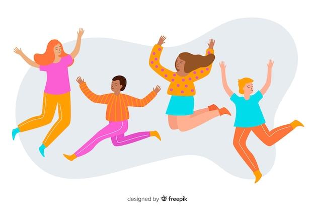 Grupa młodych ludzi skaczących i dobrze się bawiących