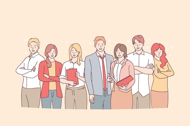 Grupa młodych uśmiechniętych pracowników biznesowych stojących razem z dokumentami w zespole w biurze i patrząc na kamery