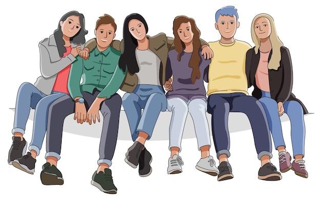 Grupa nastolatków siedzi i smilling koncepcja