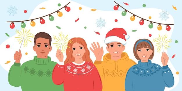 Grupa różnych ludzi w zimowych ubraniach razem na świątecznej imprezie