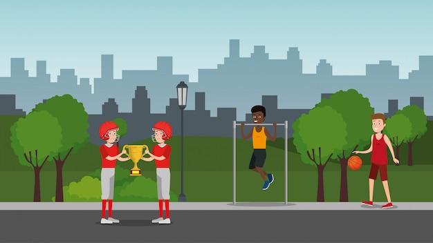 Grupa sportowców uprawiających sport w parku
