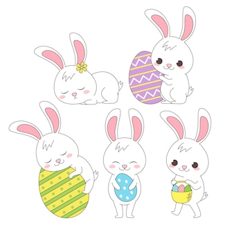 Grupa szczęśliwy ładny królik w sezonie wiosennym