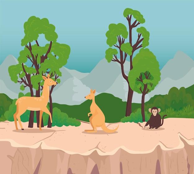 Grupa trzech dzikich zwierząt na scenie sawanny