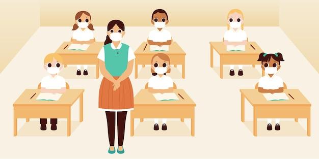 Grupa uczniów i nauczyciela w maskach w klasie