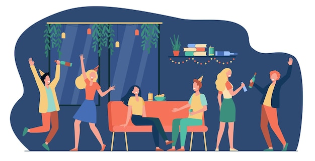 Grupa wesołych studentów lub szczęśliwych przyjaciół tańczących i bawiących się na imprezie domowej w mieszkaniu