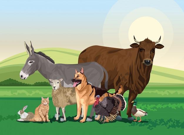 Grupa zwierząt gospodarskich w scenie krajobrazu